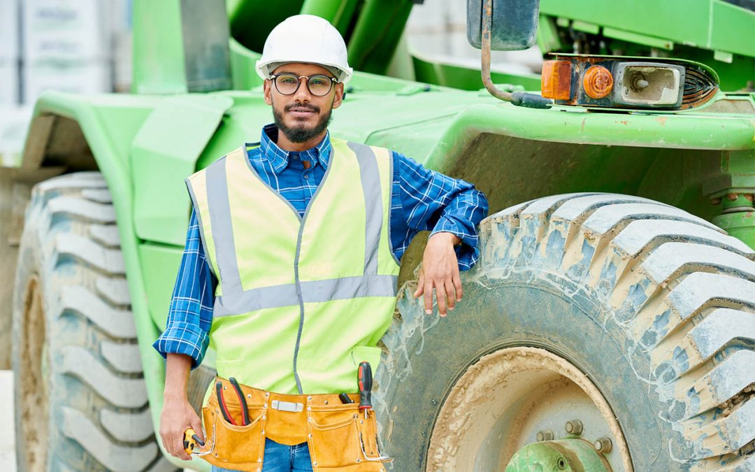 man in front of heavy vehicle